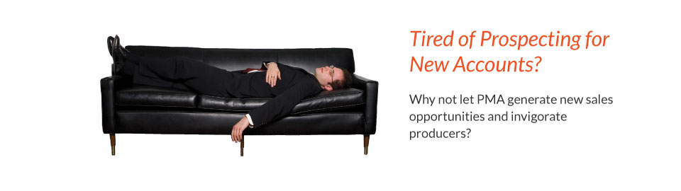 Man in suit lies on couch, exhausted